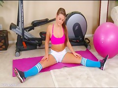 Sexy coed Abby Rocks finishes her workout with a phone call to her boyfriend
